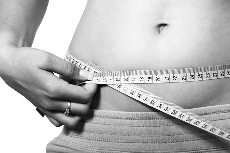 Belly and measuring tape for weight loss management